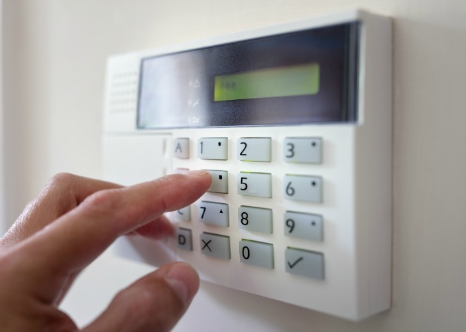 One way you can deter burglars is to invest in an alarm. If you have windows or glass near your front entrance that make it easy to see inside, make sure that the control panel for your alarm isn't visible from the outside. You don't want that would-be burglar peering in the window to see if the alarm is set or not.